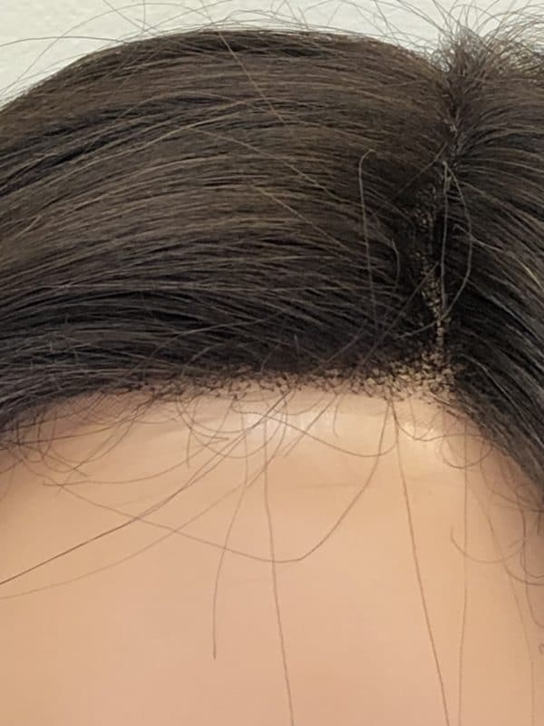 peluca de pelo sinteitico